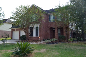 Large brick 4 bedroom home on a corner lot